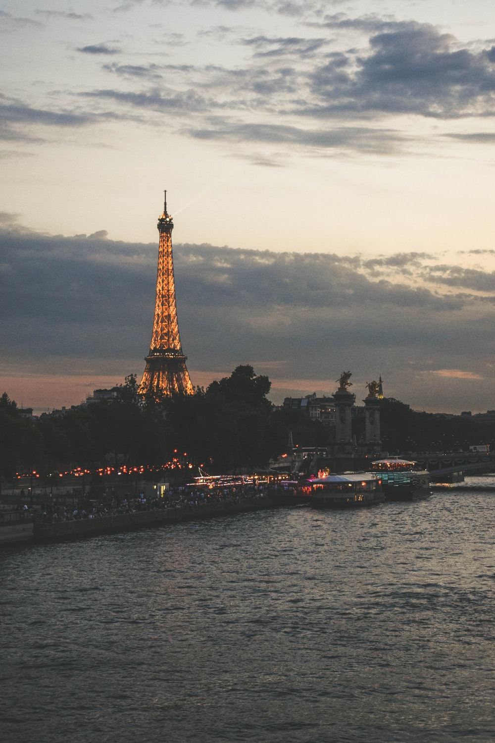 eiffel tower near body of water during daytime