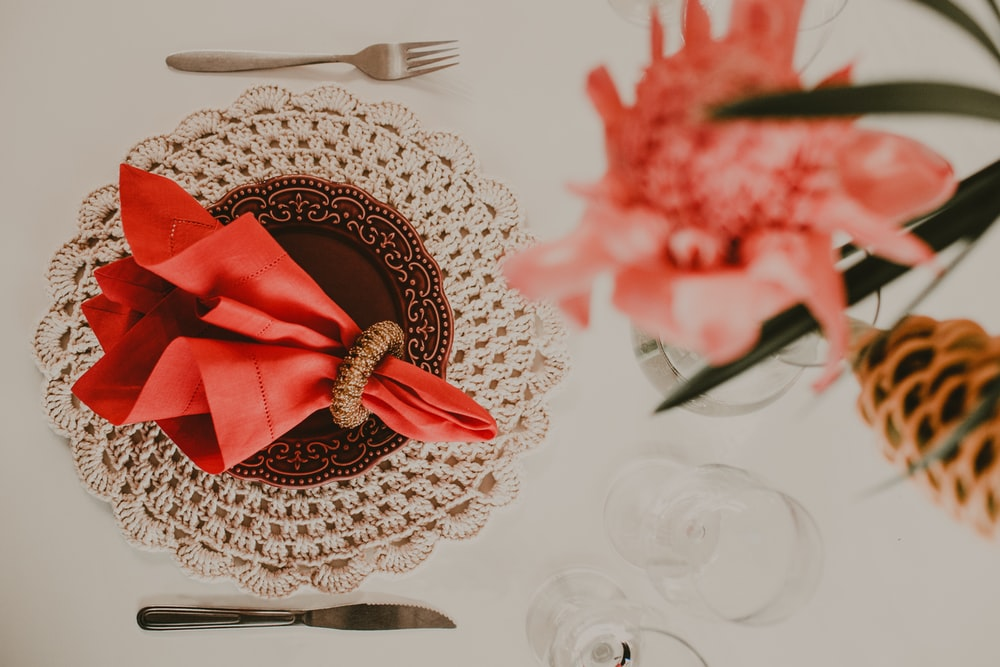 red and gold ribbon on white round table