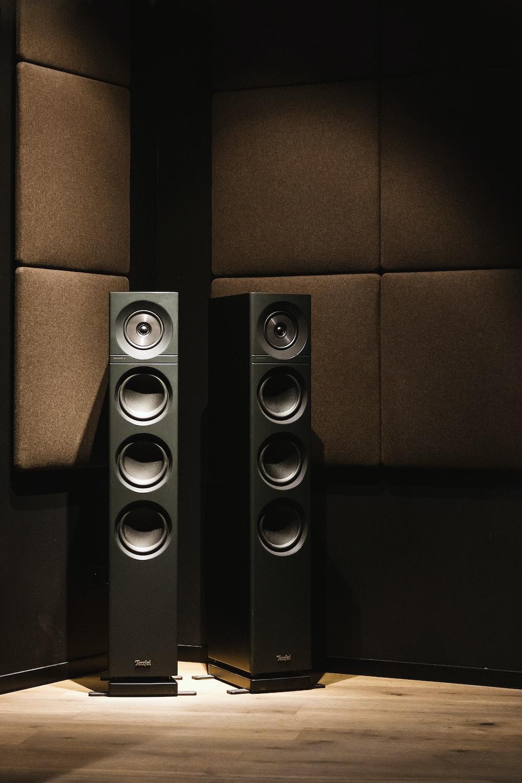 black and brown speaker on black surface