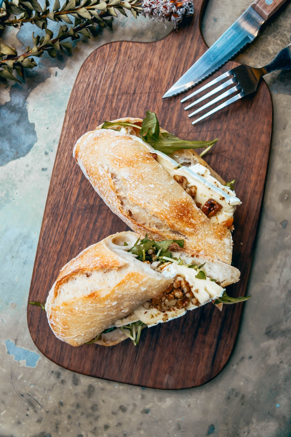 bread with cheese and vegetable on brown wooden table