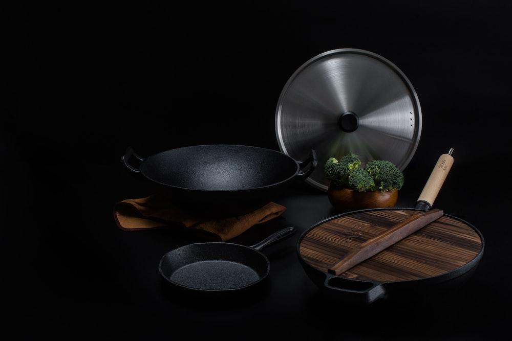 brown wooden handled stainless steel cooking pan