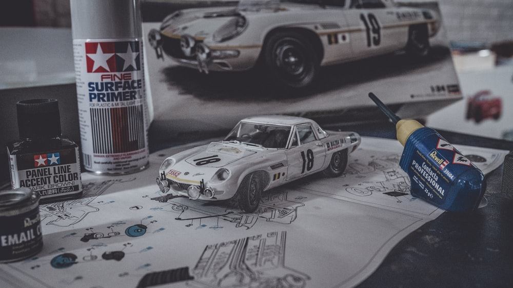 white and black coupe scale model