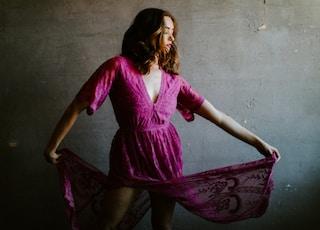 woman in purple long sleeve dress
