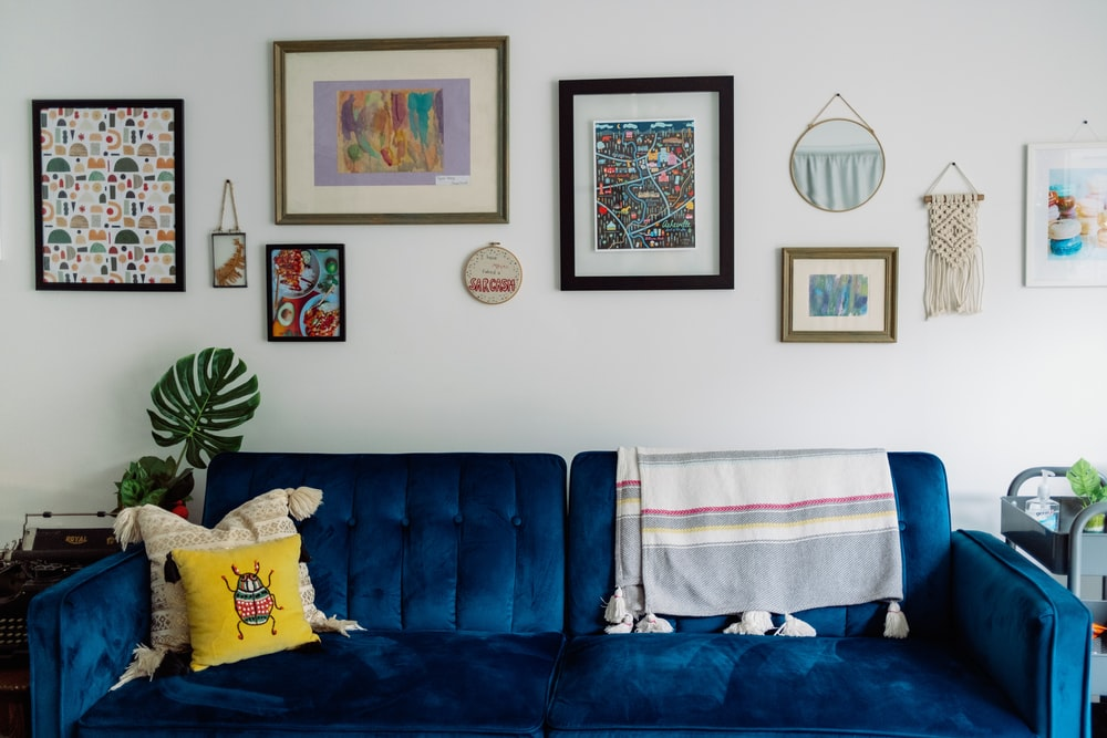 blue sofa with white and blue towel