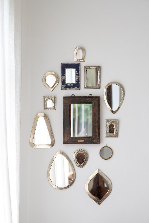 black framed wall mounted mirror
