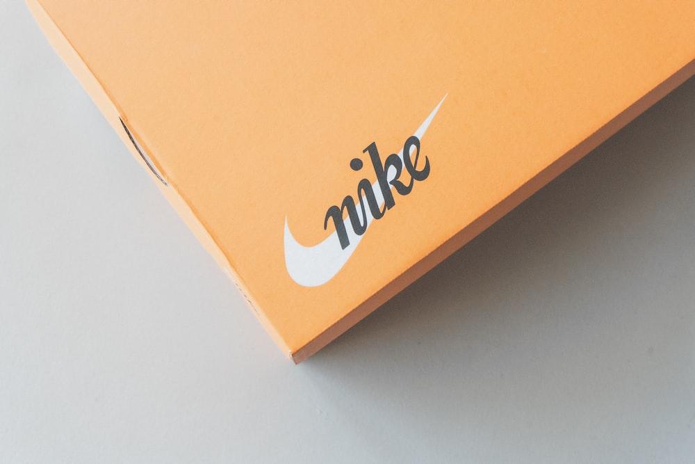 orange and white box on white table