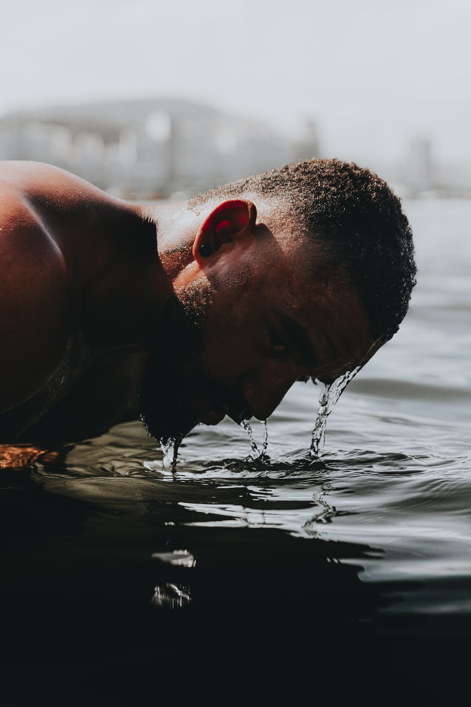 man in water during daytime