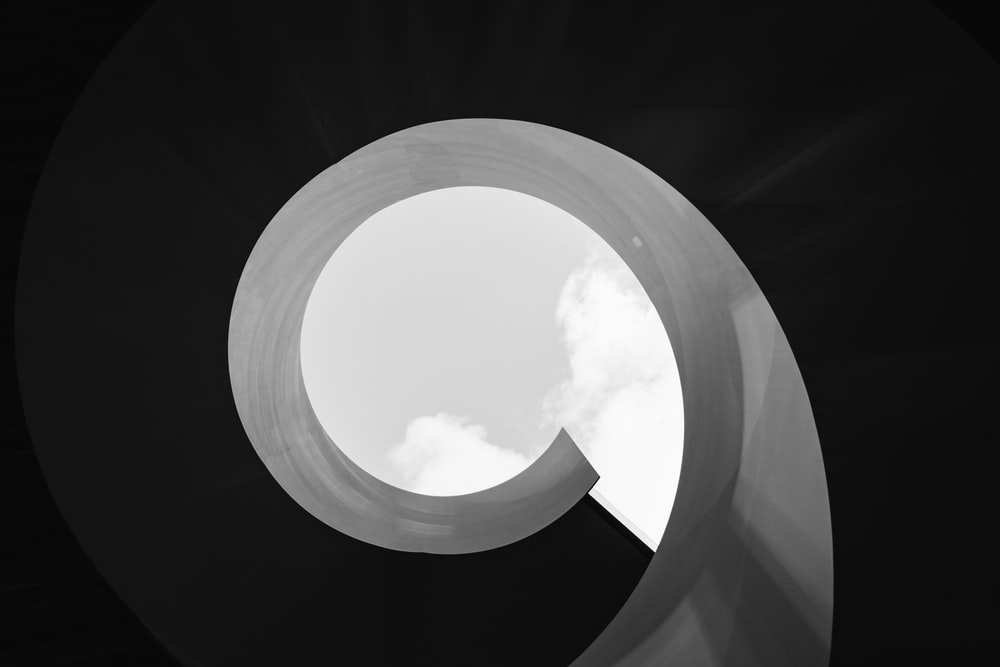 grayscale photo of round hole