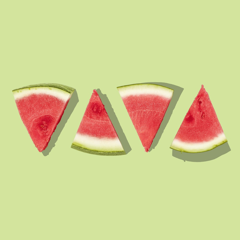 sliced watermelon with green background