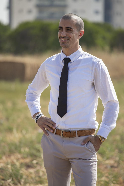 man in white dress shirt and black necktie