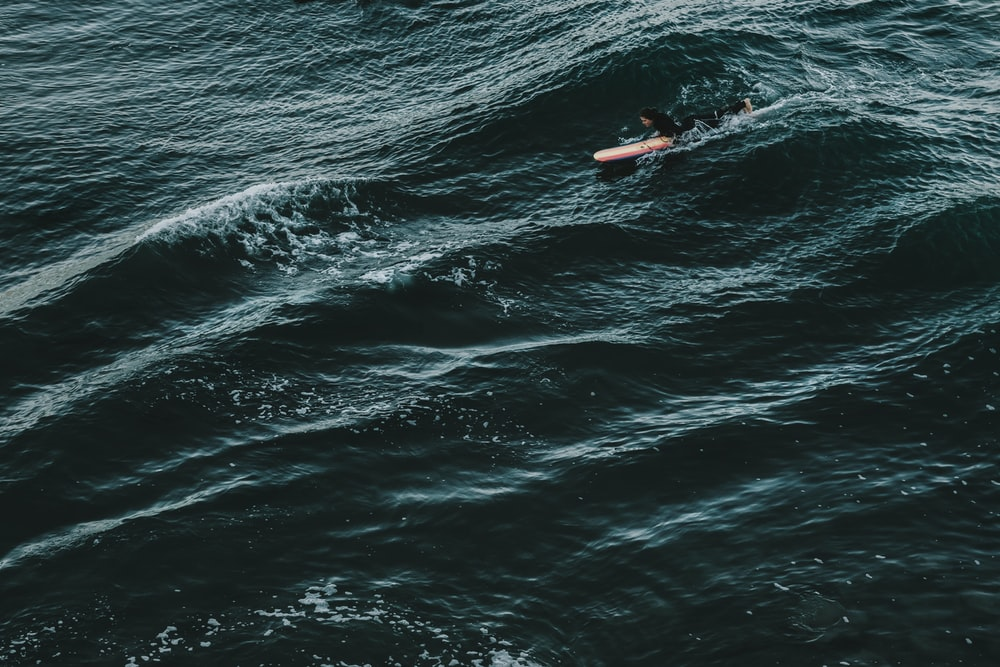 person surfing on sea during daytime