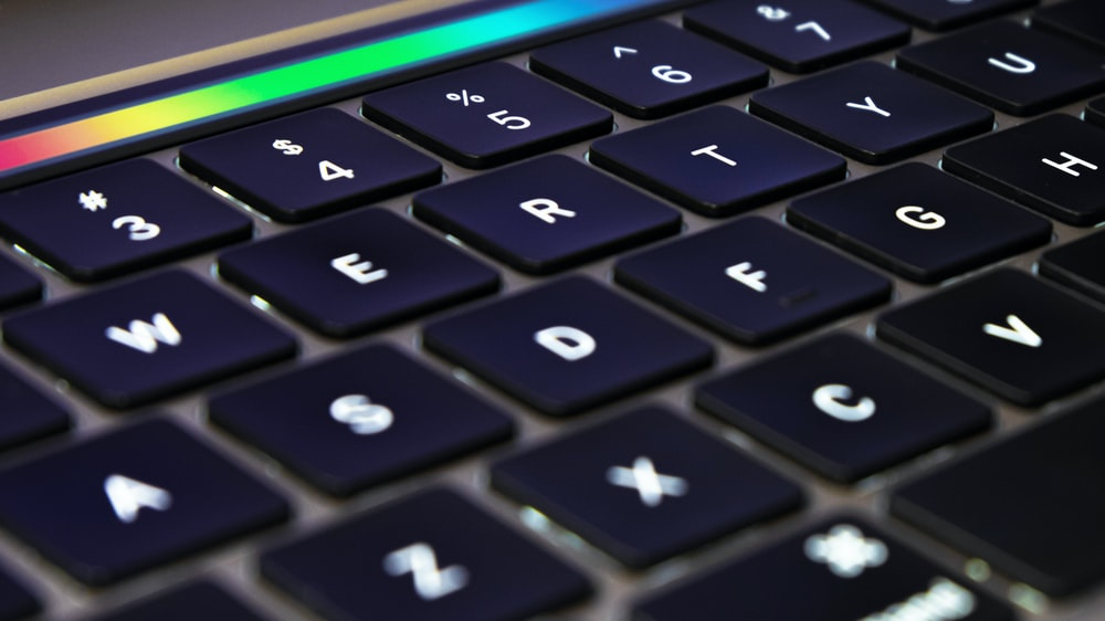 black and orange laptop computer