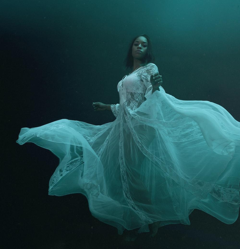 woman in blue dress in water