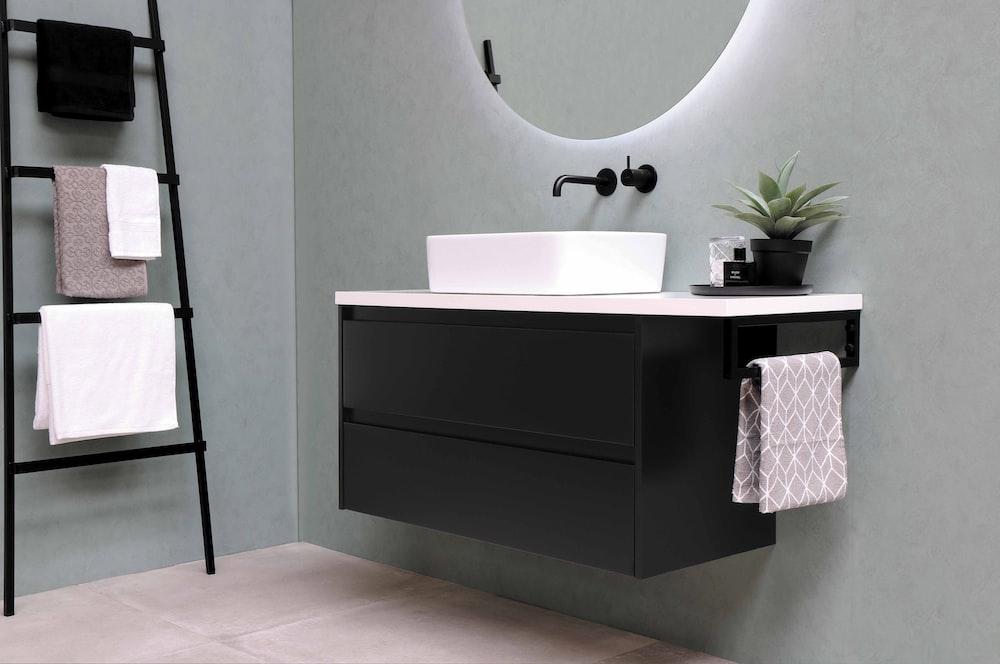white ceramic bathtub beside white wall