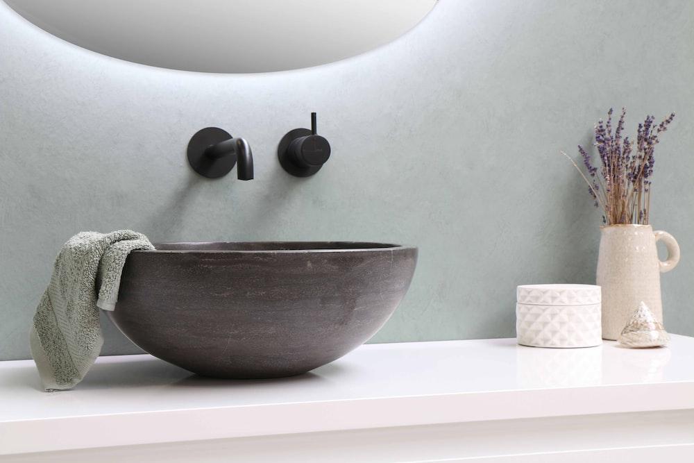 white ceramic bowl on white wooden table