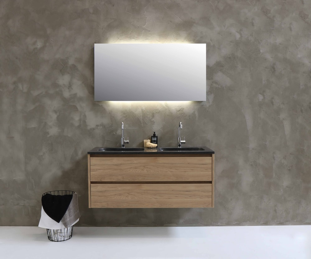 white paper on brown wooden cabinet