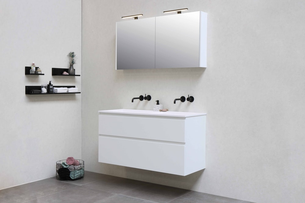 white wooden kitchen cabinet with black and white ceramic mugs on top