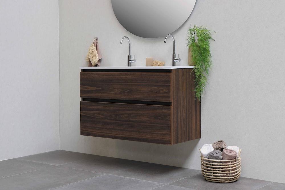 brown woven basket on white ceramic sink