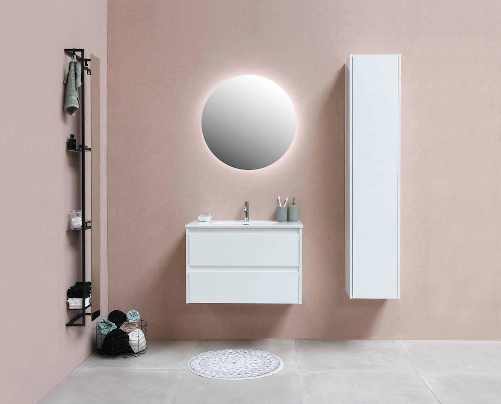 white wooden cabinet beside white ceramic sink