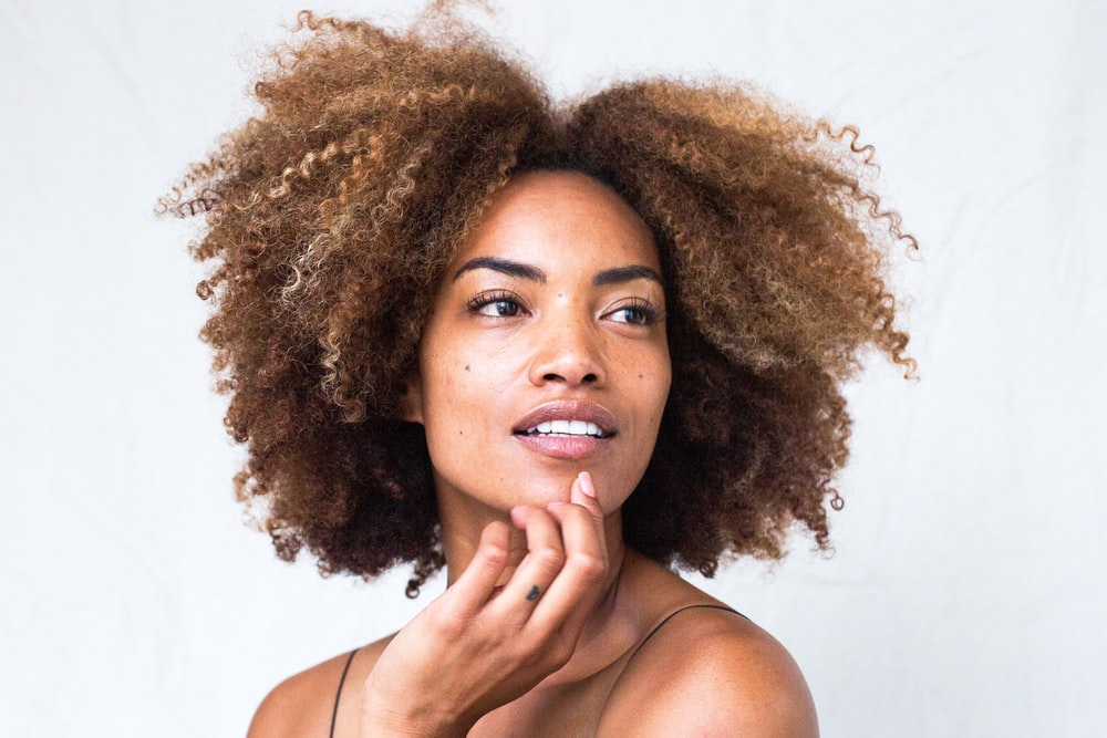 woman with brown curly hair
