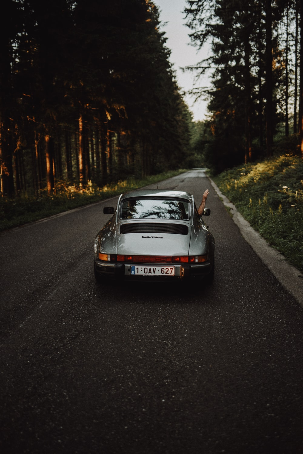 red and white porsche 911 on road during daytime