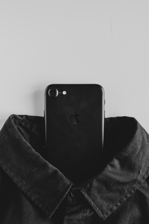 black iphone 4 on black textile