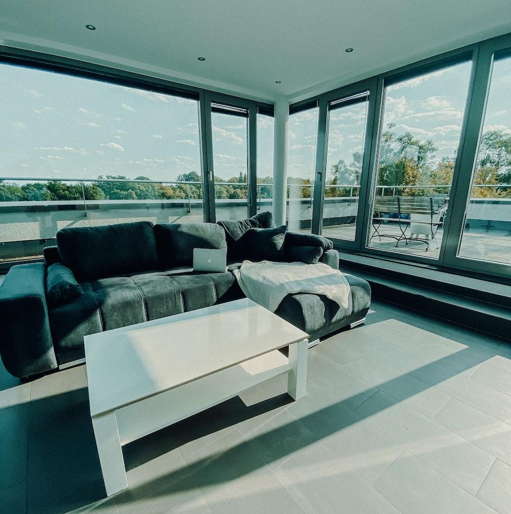 white and black sofa near glass window