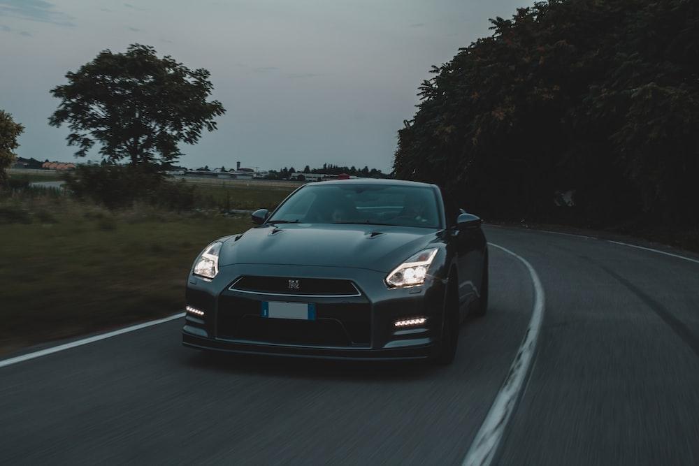 black bmw m 3 on road