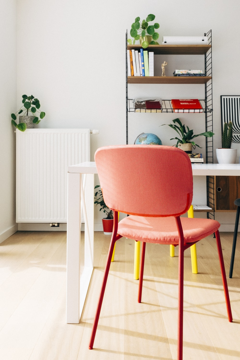 red and white chair beside brown wooden table