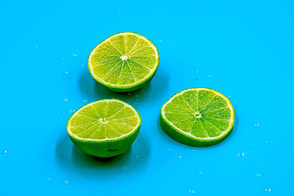 sliced lemon on blue surface