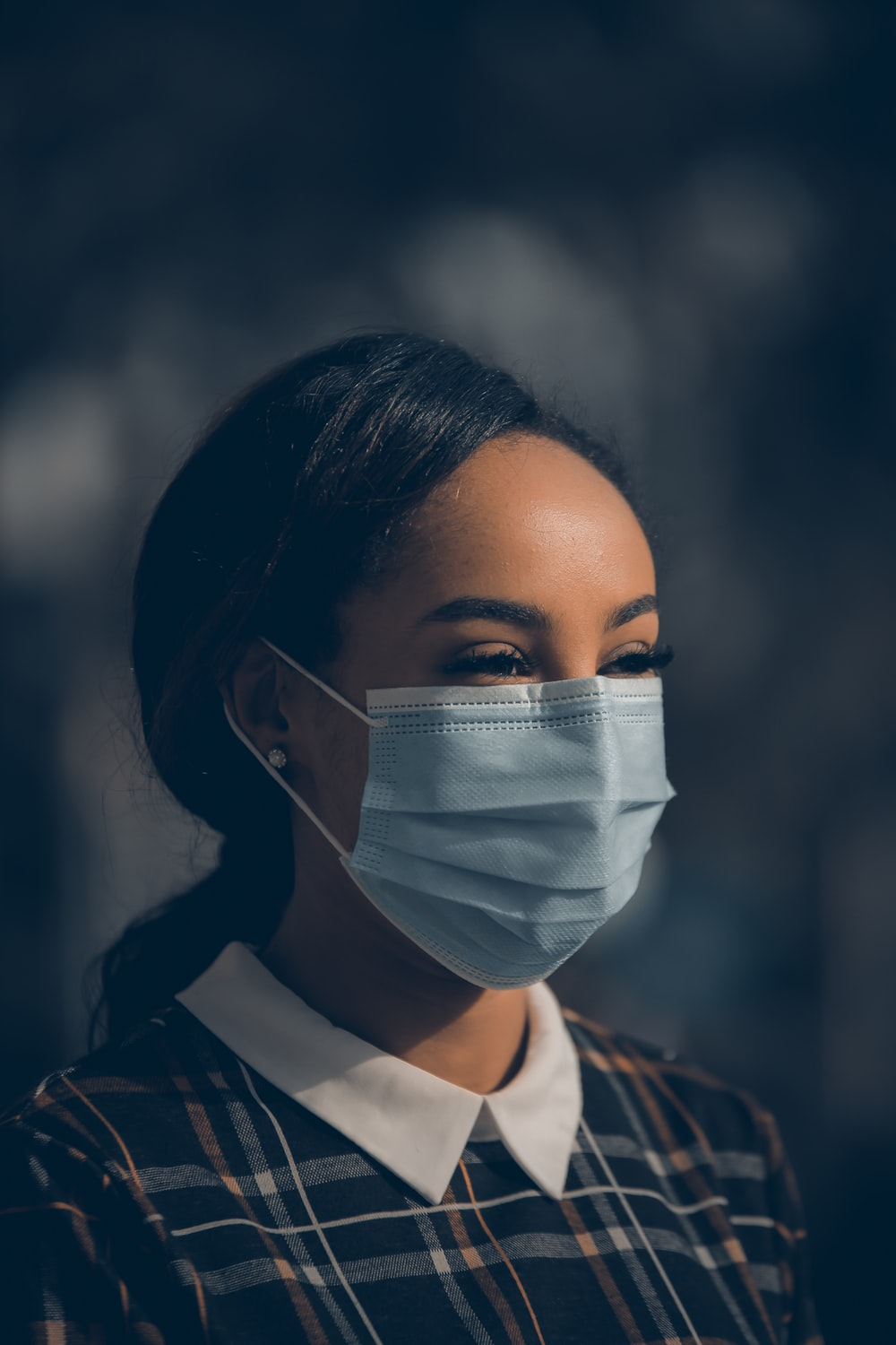 woman in black and white shirt with white face mask