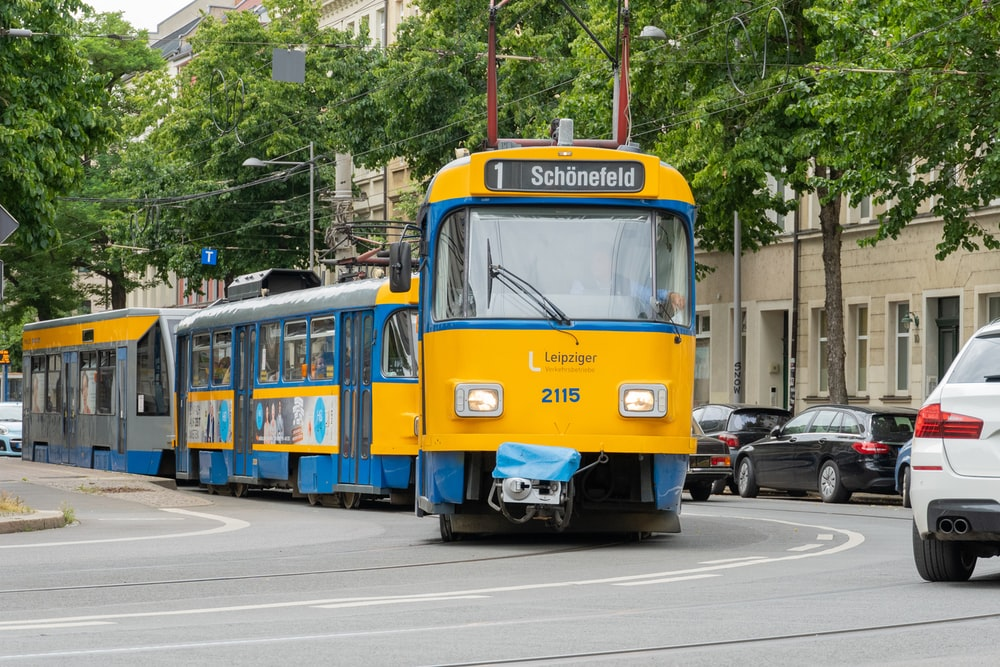 yellow and blue tram on road during daytime