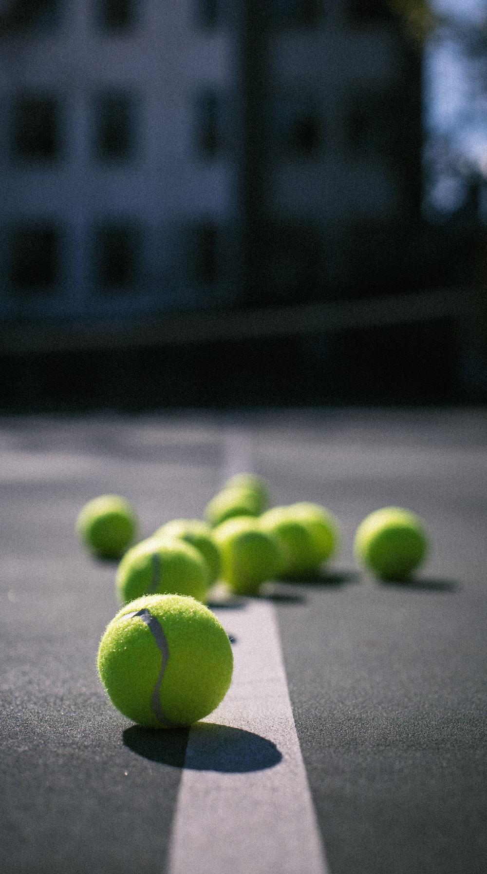 green tennis ball on gray concrete floor