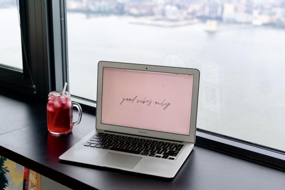 macbook air on black table photo – Free Computer Image on Unsplash