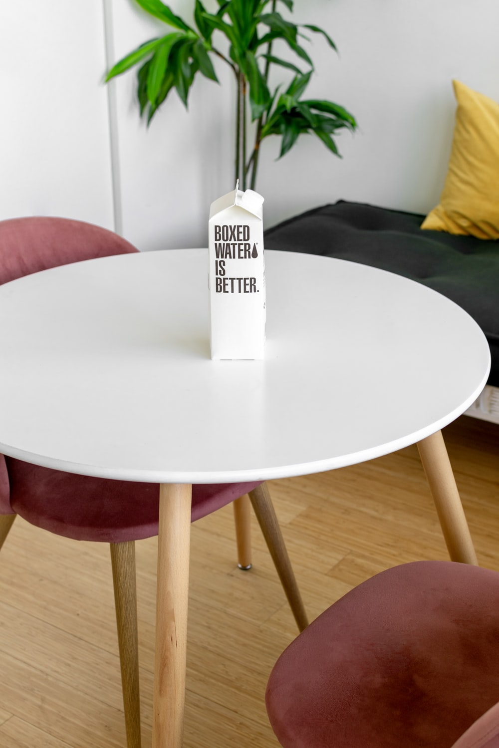 white and black labeled soft tube on round table