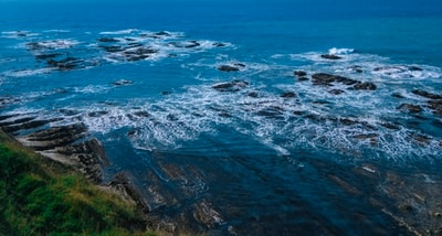aerial view of ocean waves crashing on shore during daytime south island zoom background