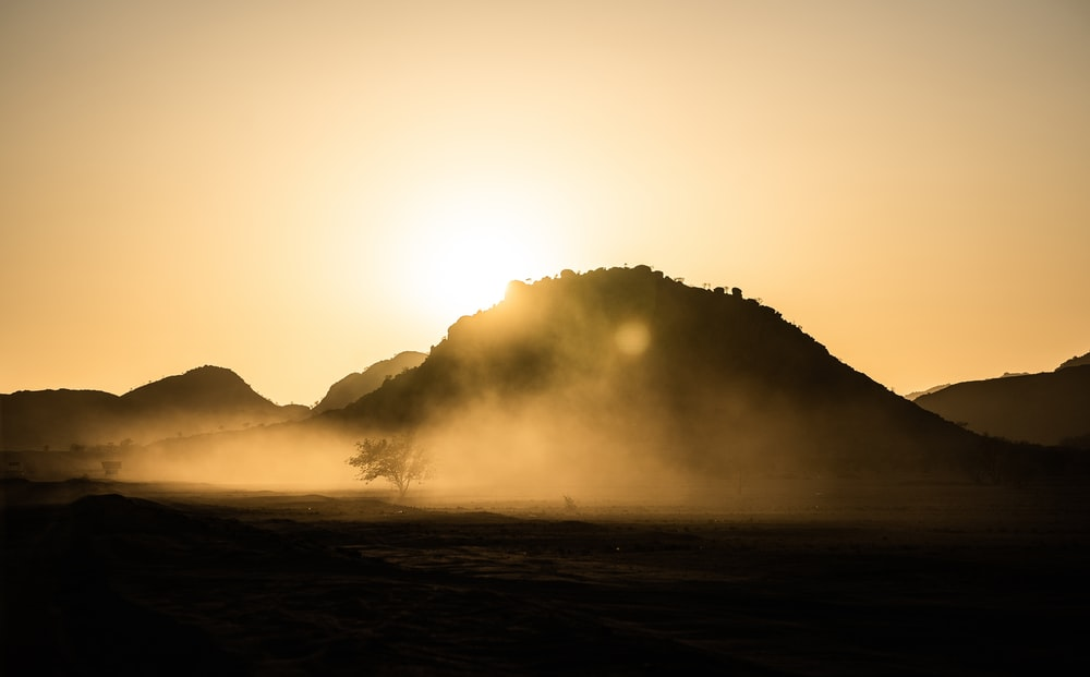 silhouette of mountain during foggy day