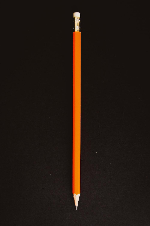 orange pencil on black textile