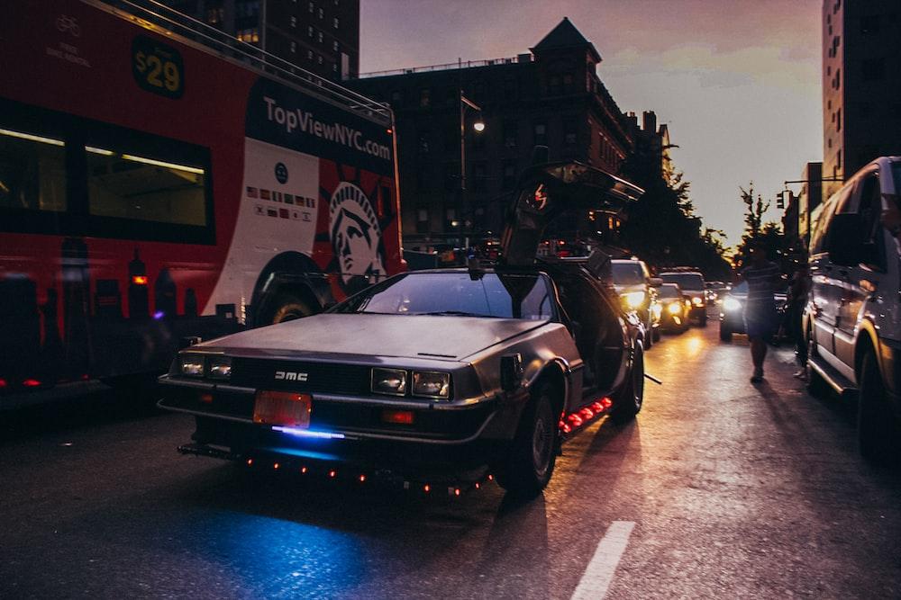 black porsche 911 parked on street during night time