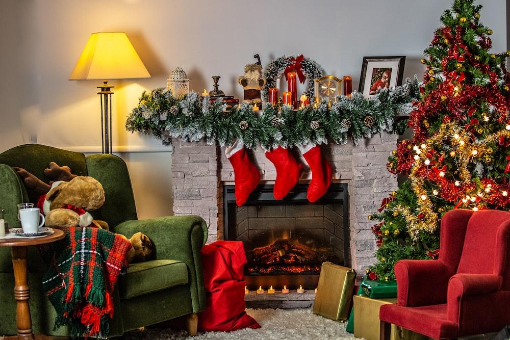 green sofa chair beside green christmas tree