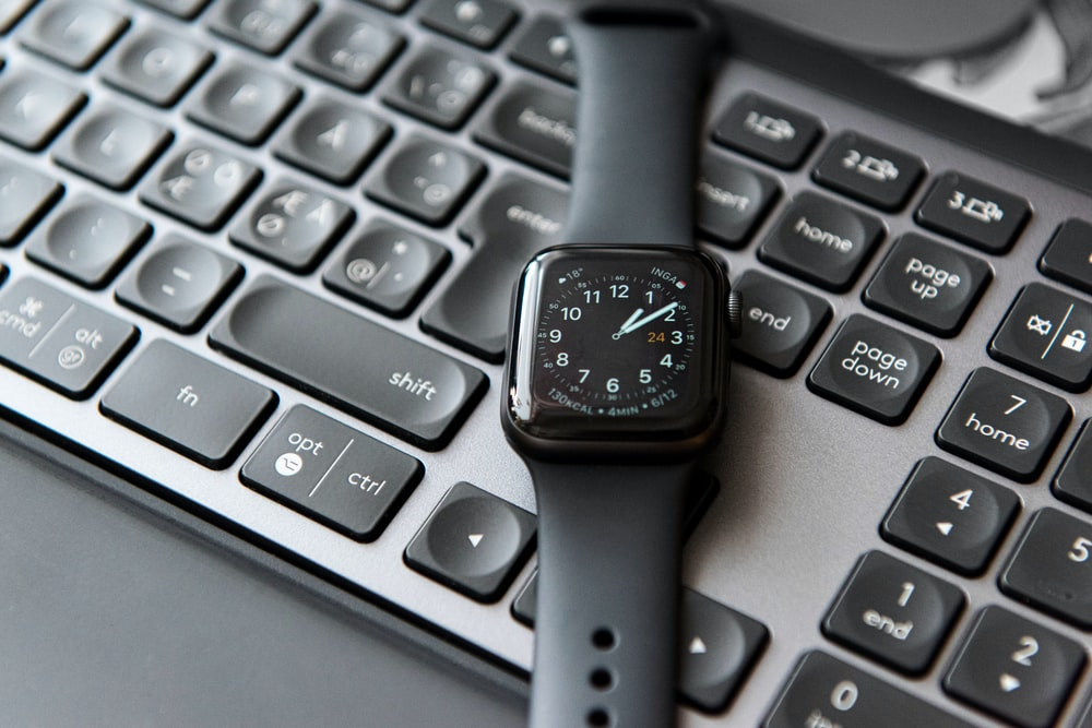 silver and black apple watch at 10 10