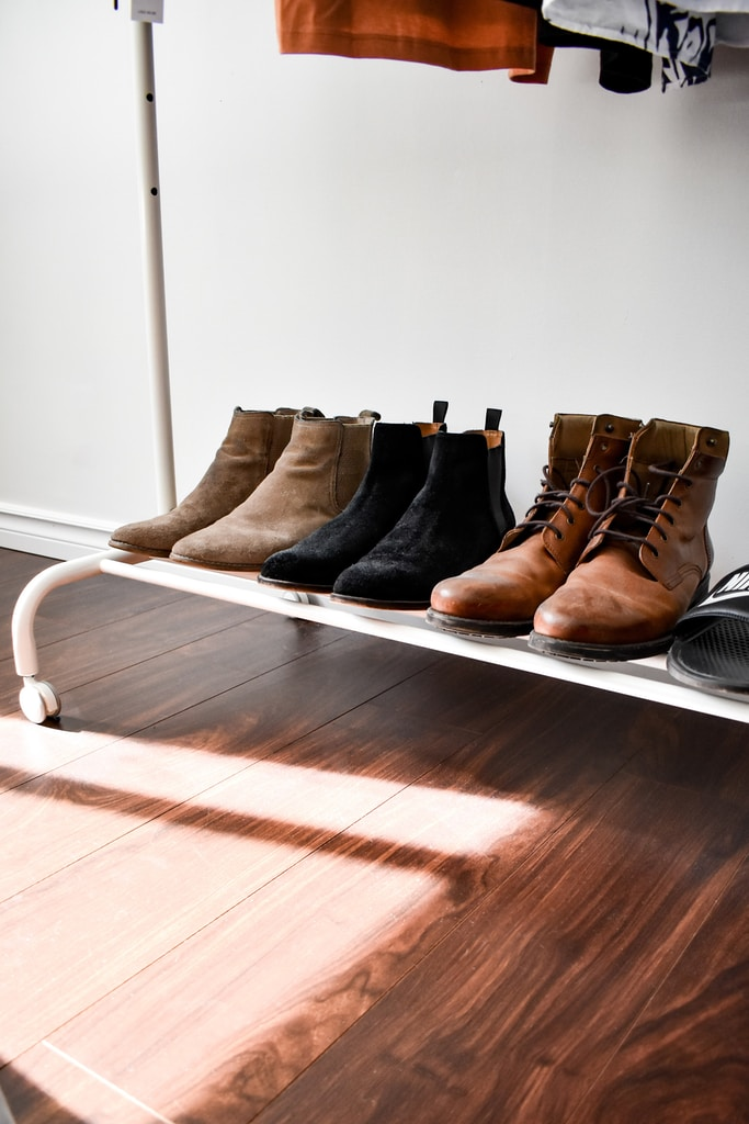 black and brown leather boots on brown wooden floor