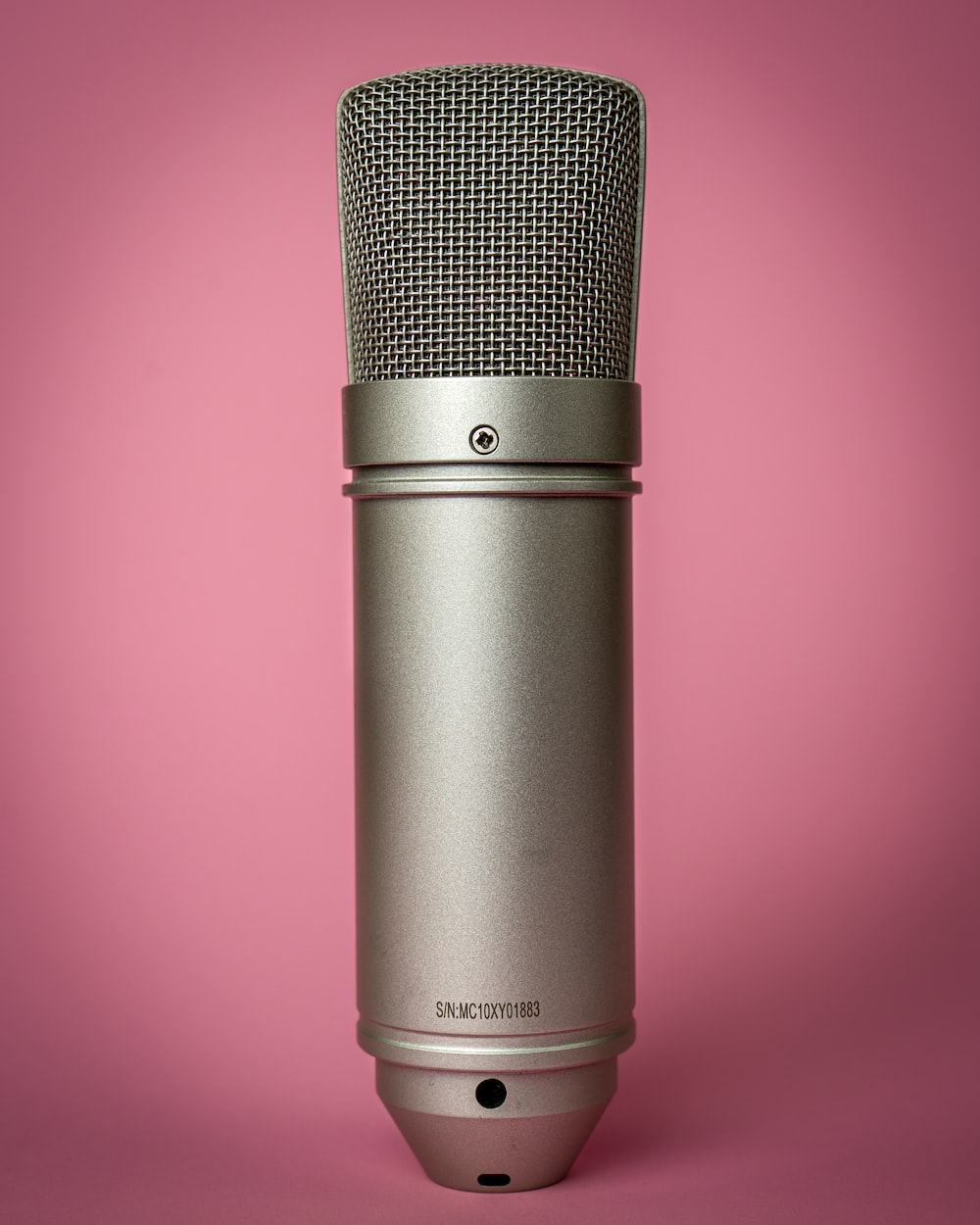 black microphone on pink background