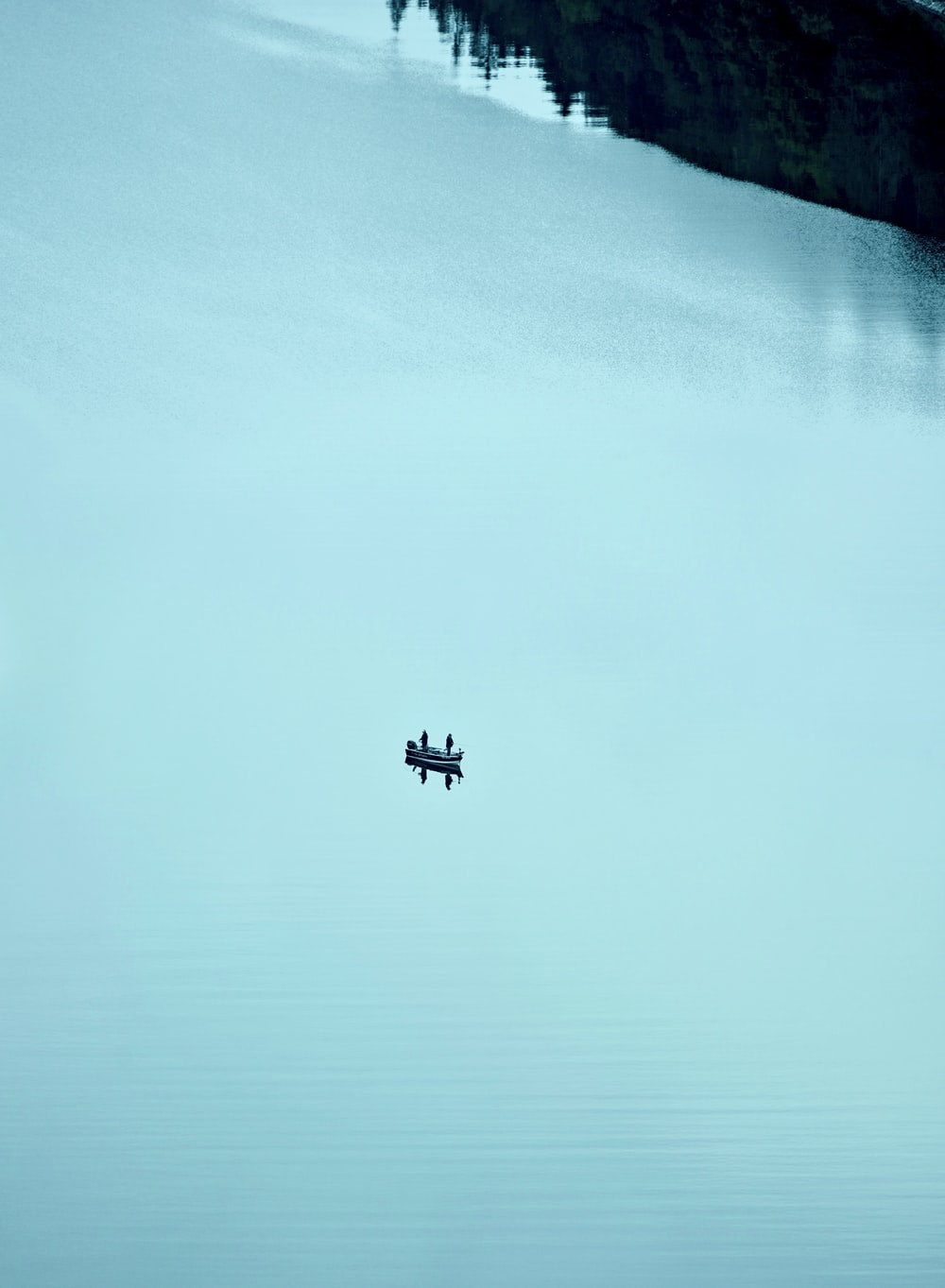 airplane flying over the sea during daytime