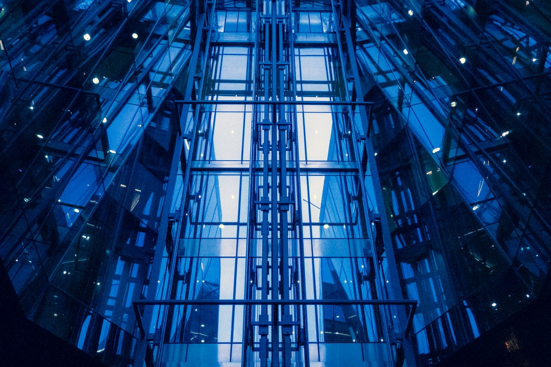 The lift shaft on the inside of a shopping mall, opposite St. Paul's Cathedral.