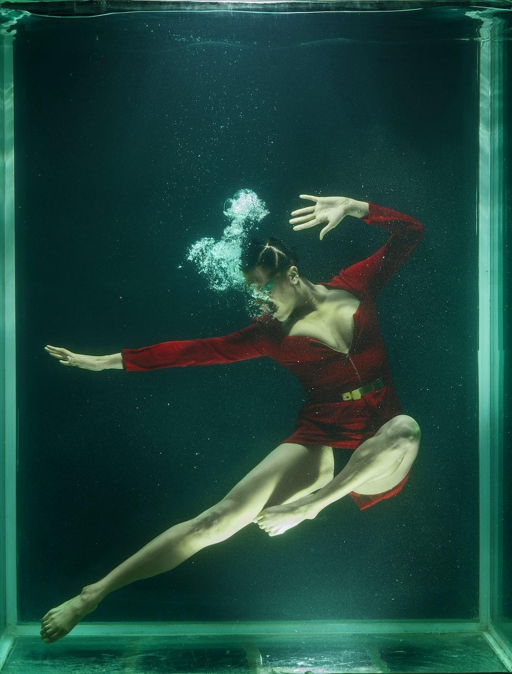 woman in red bikini under water