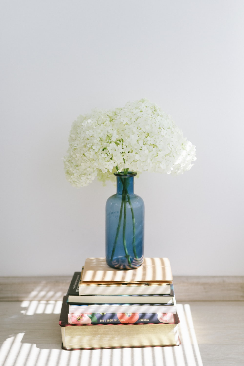white flower bouquet on brown wooden table