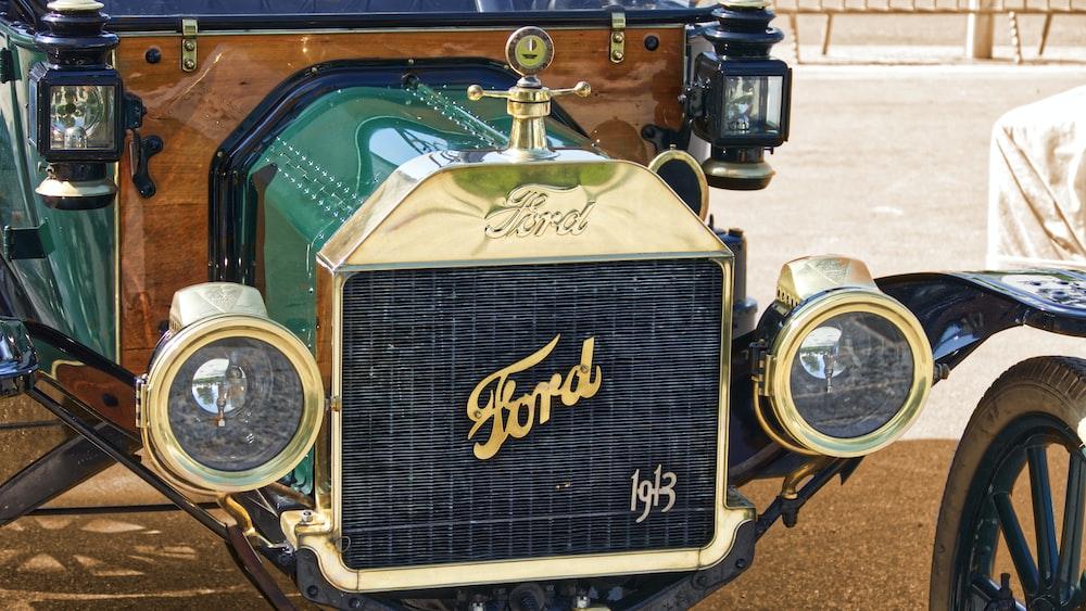 vintage black and gold vintage car