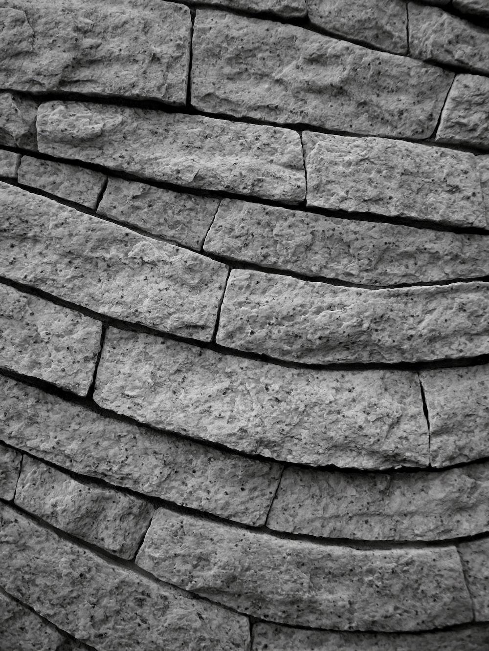 gray brick wall during daytime