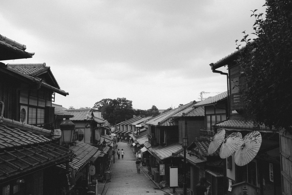 grayscale photo of houses and buildings